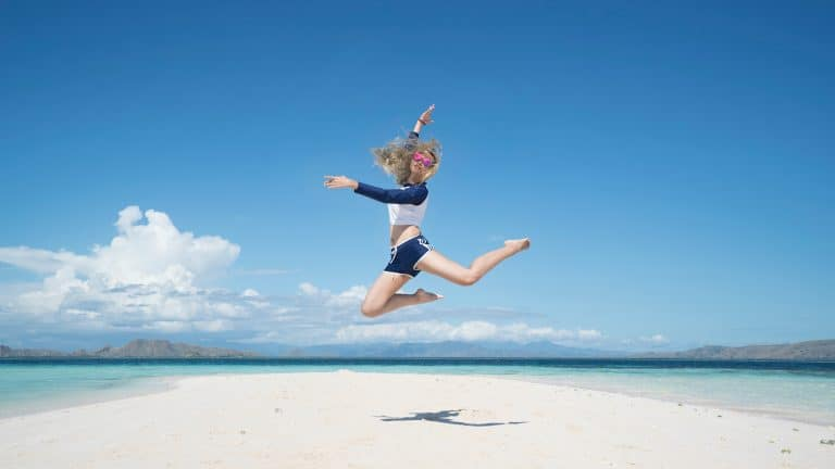 woman jumping for joy for her successful life