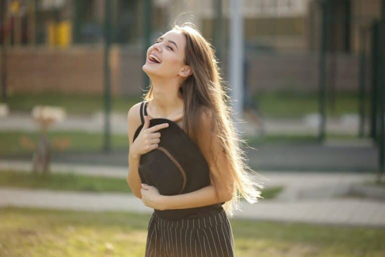 girl laughing because laughter is good for the soul