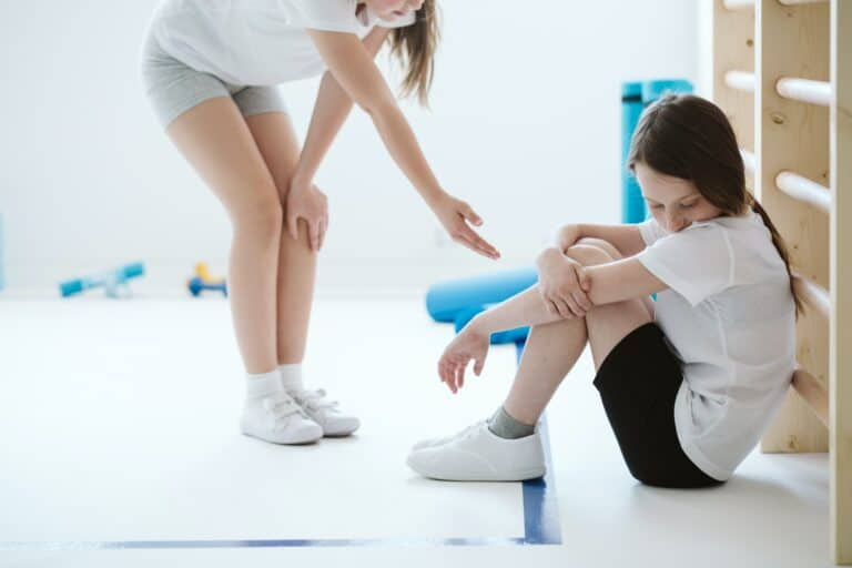 Schoolgirl reaches out to her sad friend in the gym and example of being there for someone