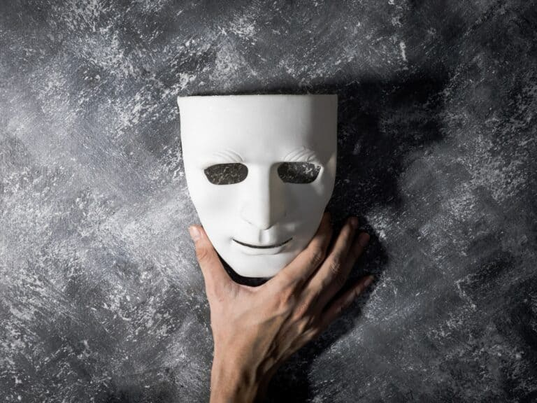 a mask, hiding behind a mask, pretending to be someone you're not