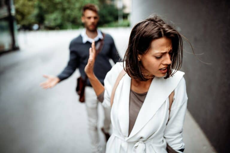 woman waving off man in a toxic relationship