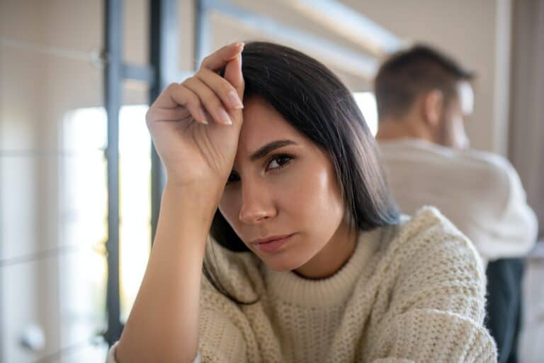woman put off by partner and experiencing relationship ups and downs