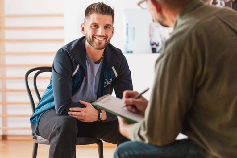 Man in therapy session discussing his growth after trauma