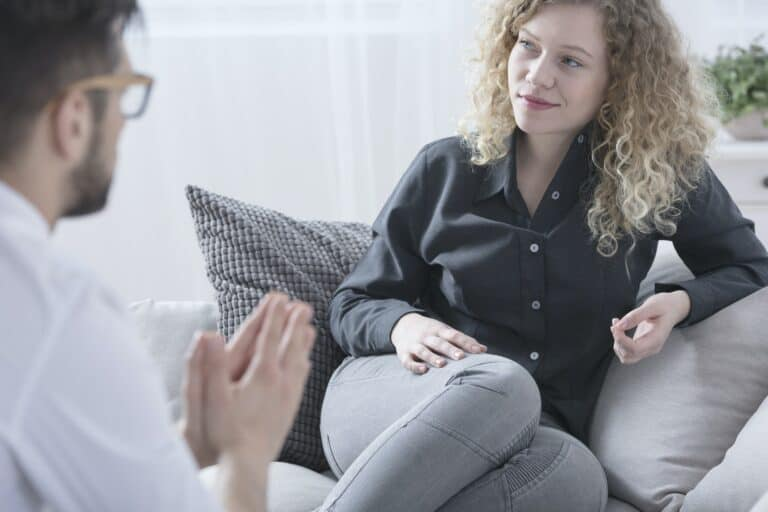 Woman smiling during therapy